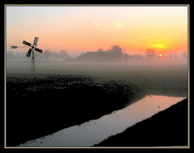 Mill,sunset and mist