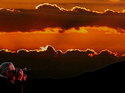 Photographer at sunset