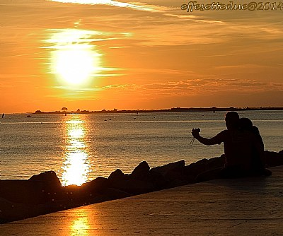 ...taking pictures at the sunset...